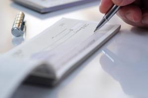Prepare writing a check in office